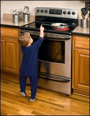 Child reaching toward hot stove